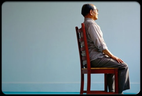 Facts_of_back_pain_a_man_sitting_straight_in_chair